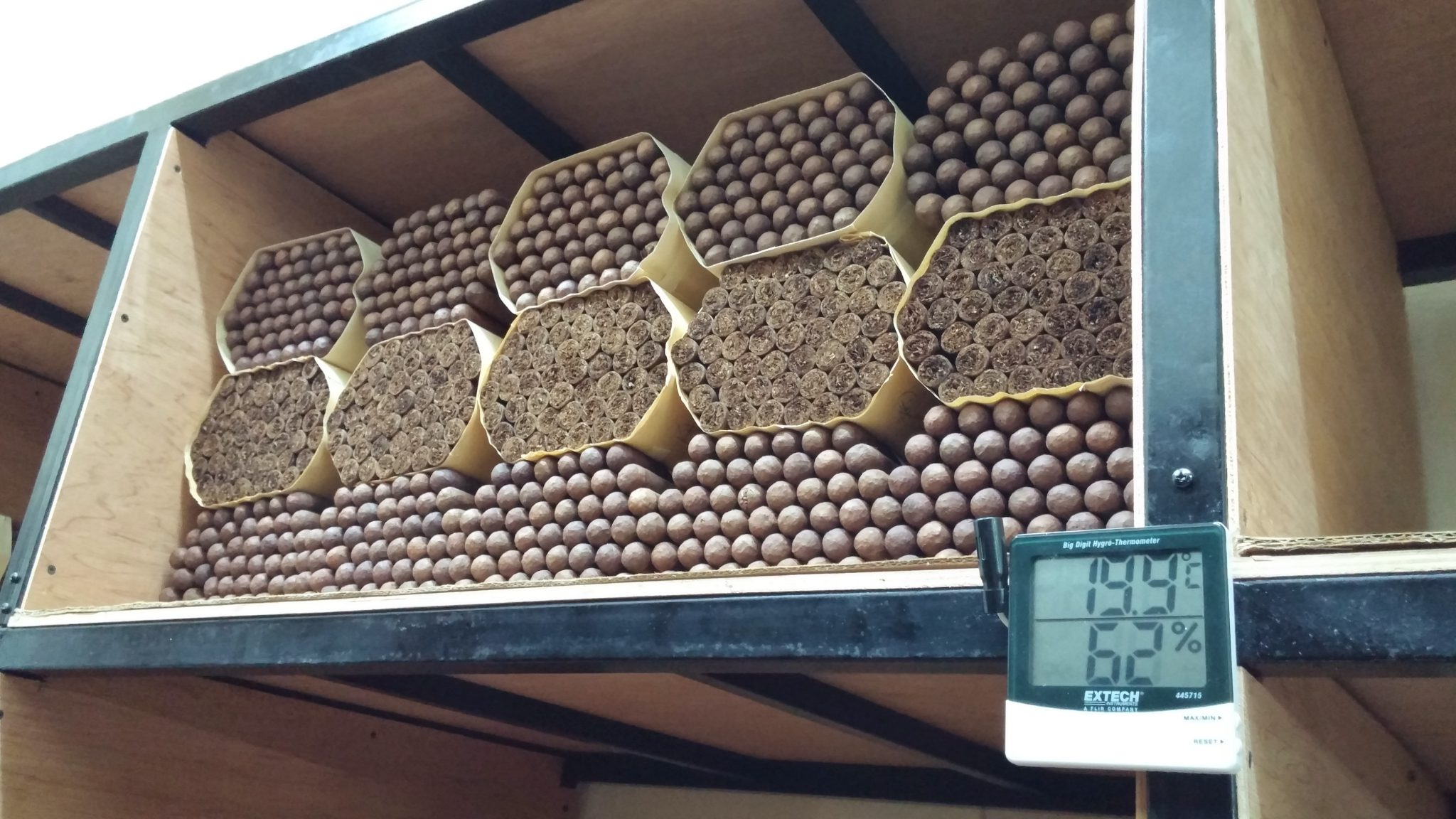 5 things about aging cigars - cigar factory aging room with cigars