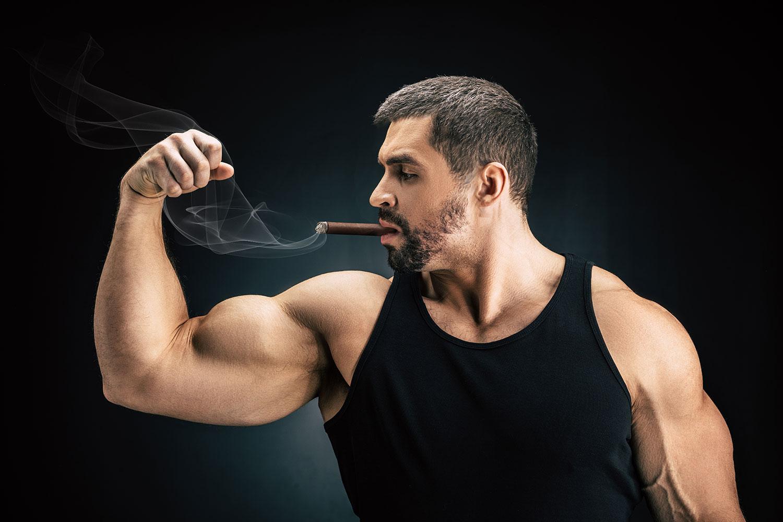 top strong cigars muscular man smoking cigar