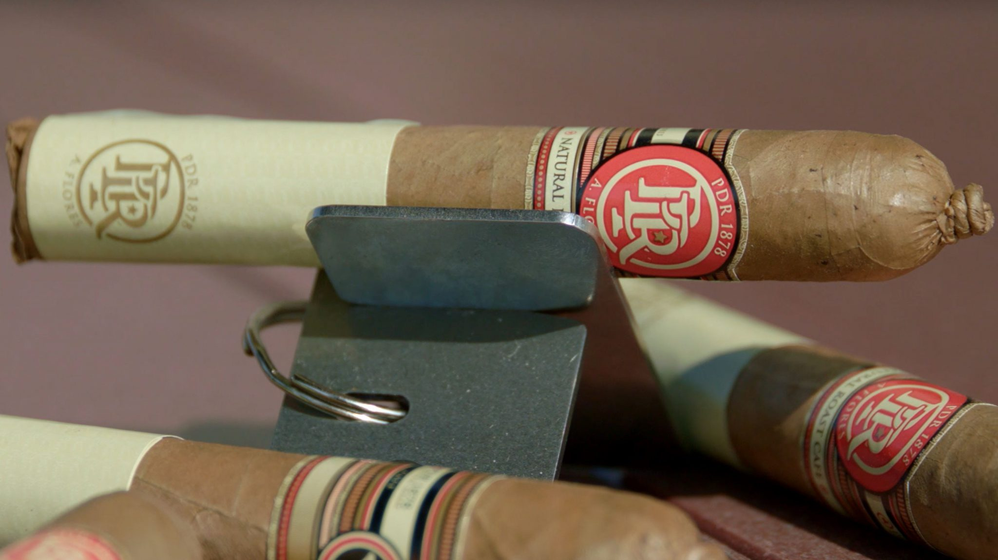 PDR cigars PDR 1878 Natural Roast Café Cigar Review at Famous Smoke Shop cigar setup shot on table
