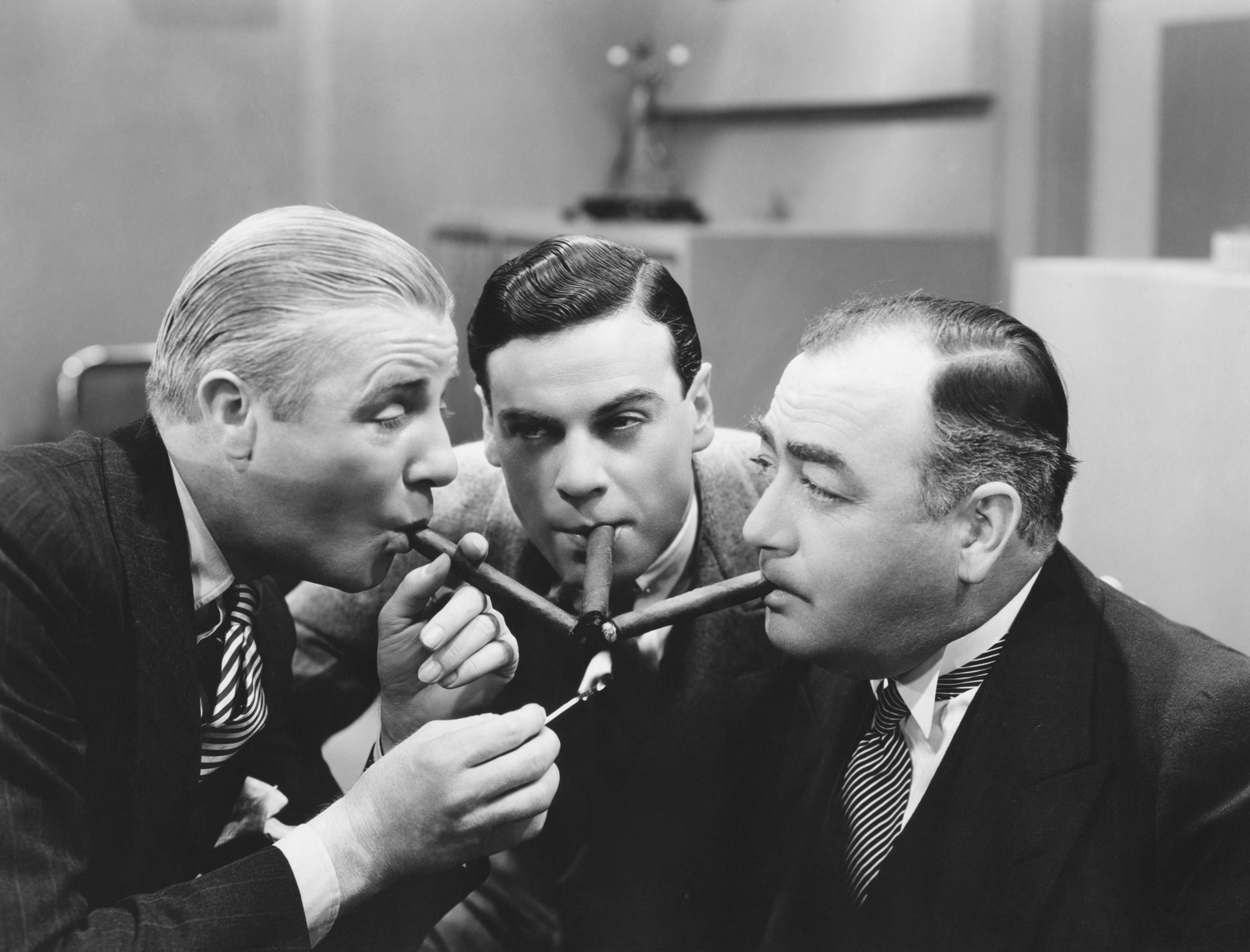 Top New Baby Cigars Best It's a Boy Cigars It's a Girl Cigars three men celebrating with cigars together