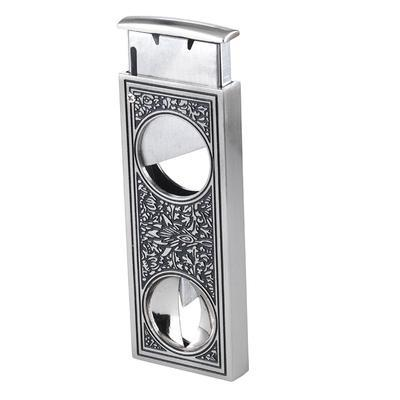 Retro Combo Cutter - Silver Retro Combo Cutter Silver Cigar Cutters are the perfect addition to any cigar collection. Made with a gorgeously decorated design reminiscent of the days of old, this cutter contains two cutters that allows you to cut both more traditional vitolas as well as over-sized stogies. Get yours now!